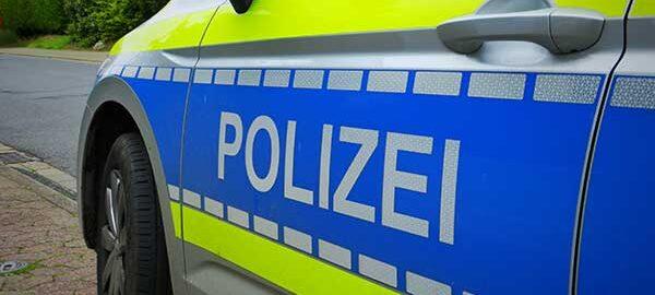 Nahaufnahme eines Polizeiautos - Arbeitsrecht